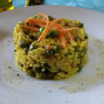 Risotto al curry con piselli