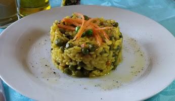 Risotto al curry con piselli